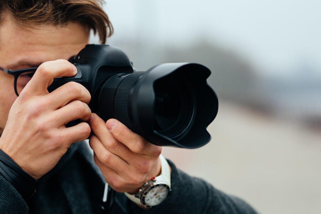 Photographer taking pictures of people and invading their privacy.