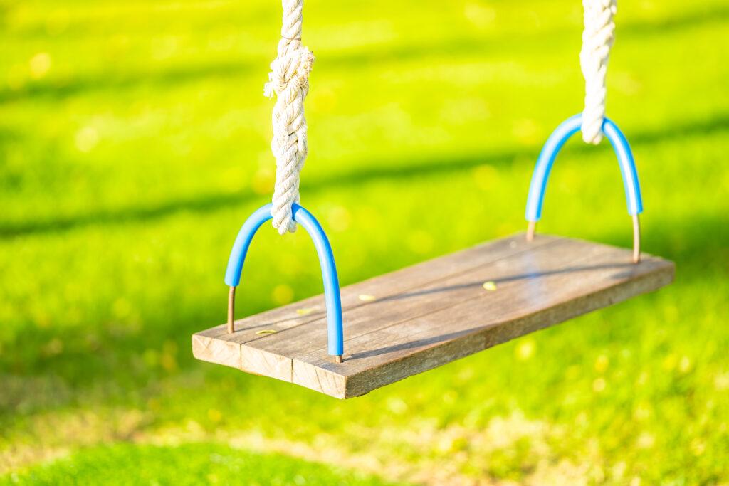 Empty swing in the garden park