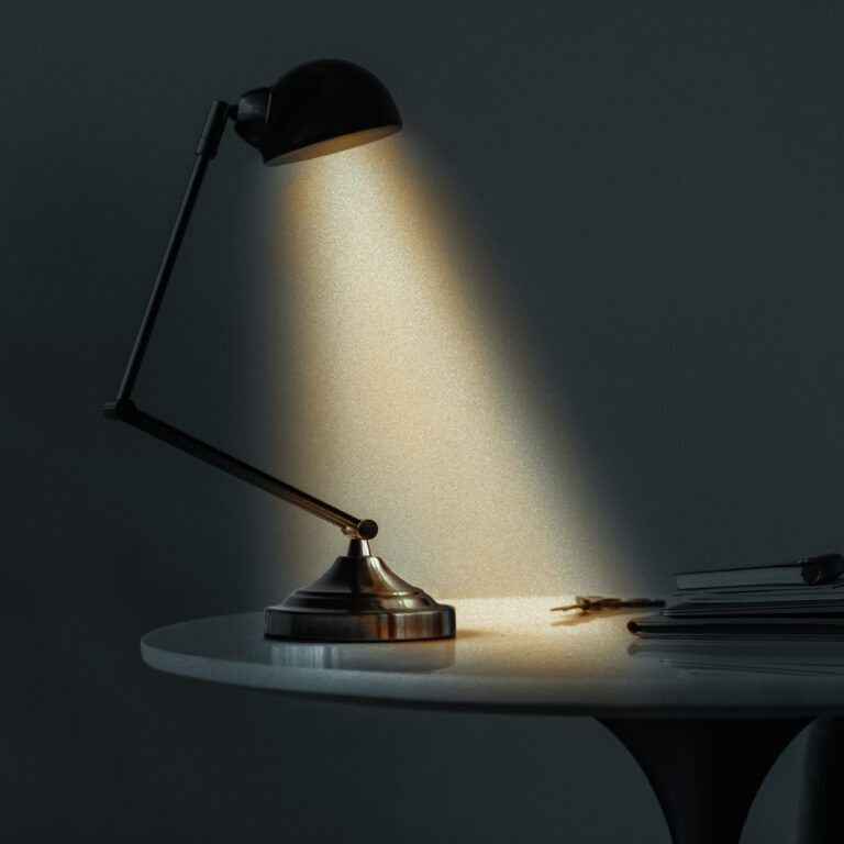 Vintage desk lamp illuminating the dark