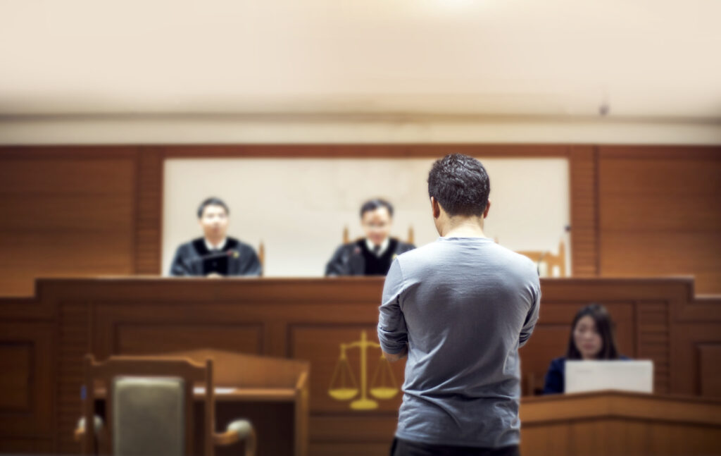 A car accident plaintiff in a courtroom.