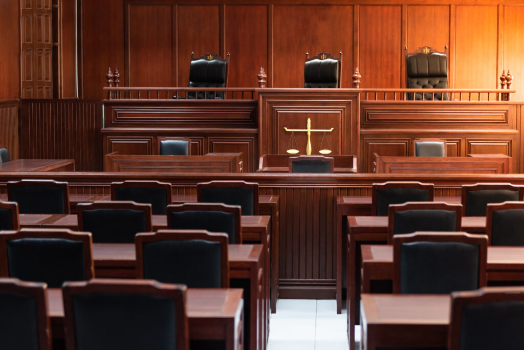 Red wood table and red chair in the justice court