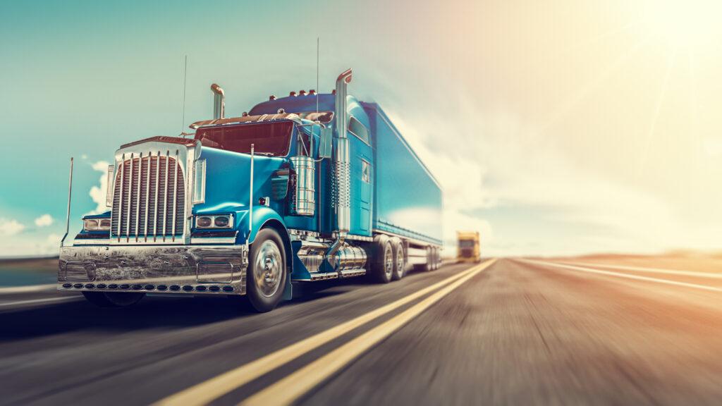 Blue semi truck on highway.