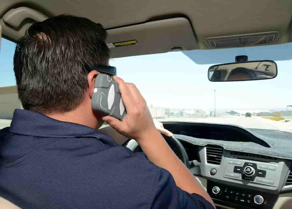 Man on phone driving