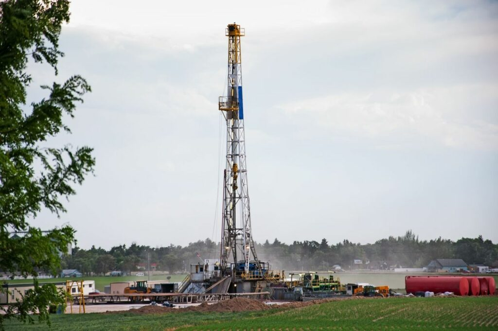 A natural gas drilling rig in a field.