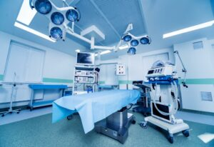 empty surgery room with bed and surgical machines
