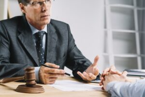 car accident victim consulting with an attorney and talking about how to decline to admit fault