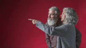 older couple pointing finger and casting blame at a person out of frame