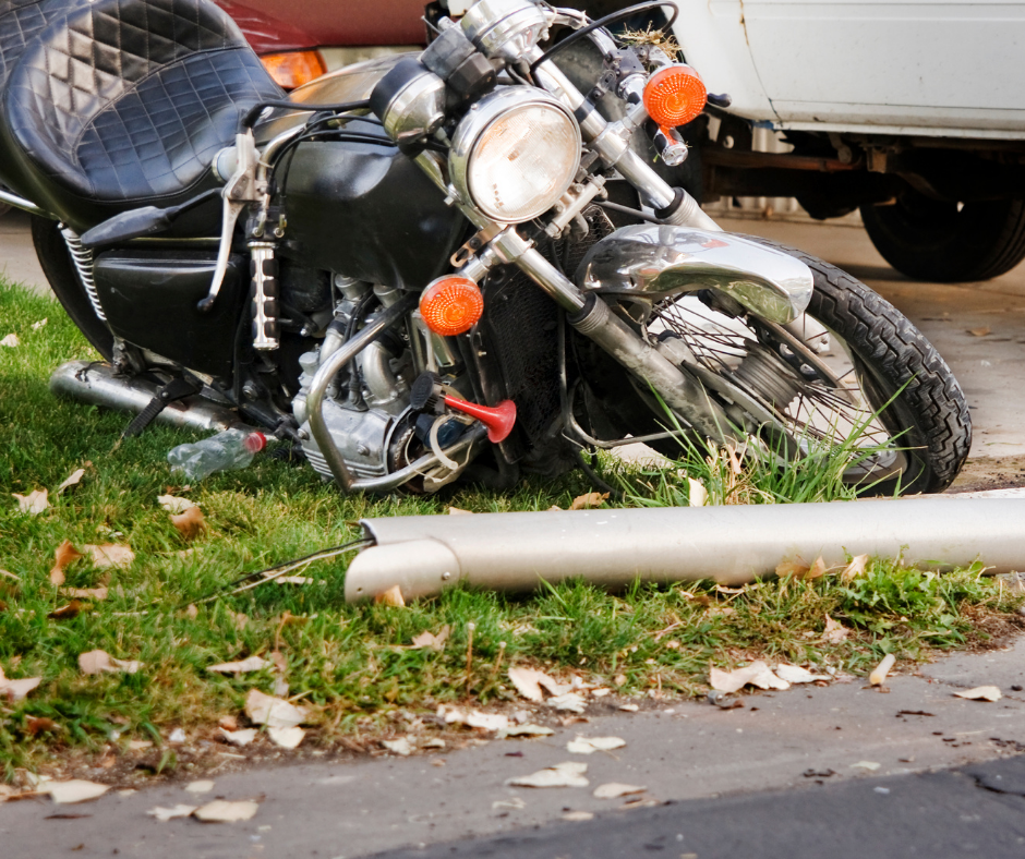Damaged motorcycle on the grass after being crashed