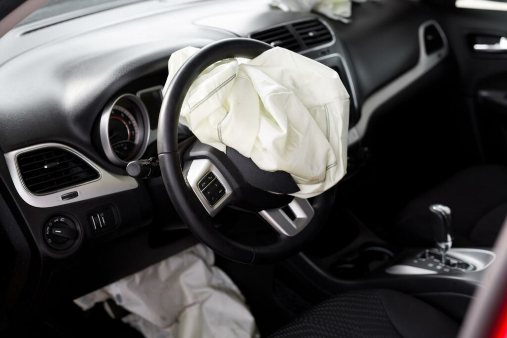 interior of car with airbag deployed