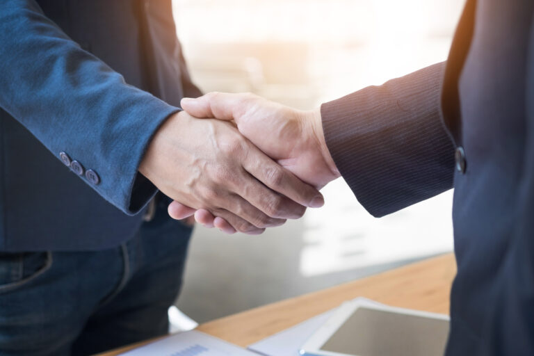 Client shaking hands with personal injury lawyer