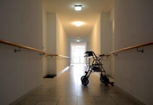 Walker in nursing home in front of patients door