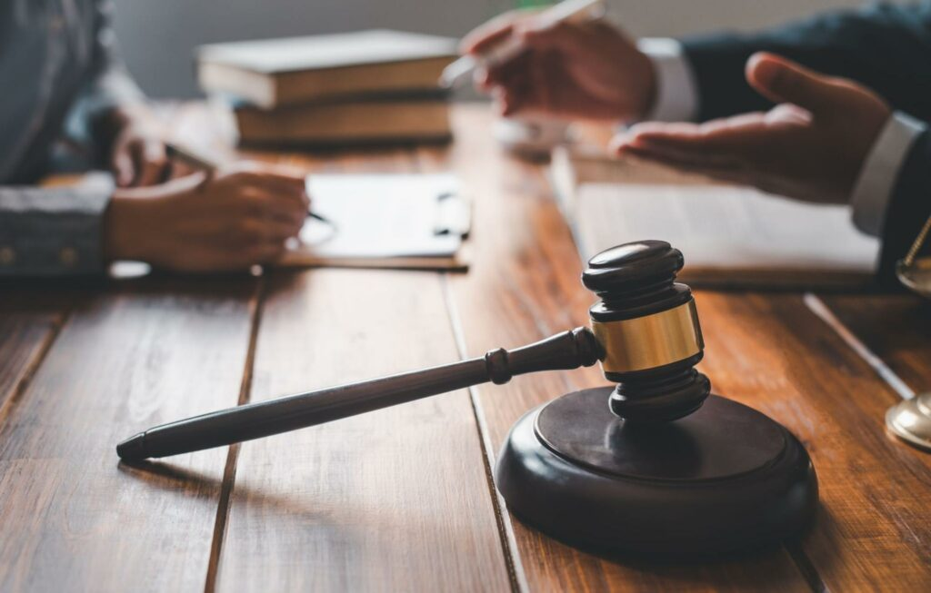 A car accident victim and an attorney have a consultation together to discuss the rights of the driver and their legal options.