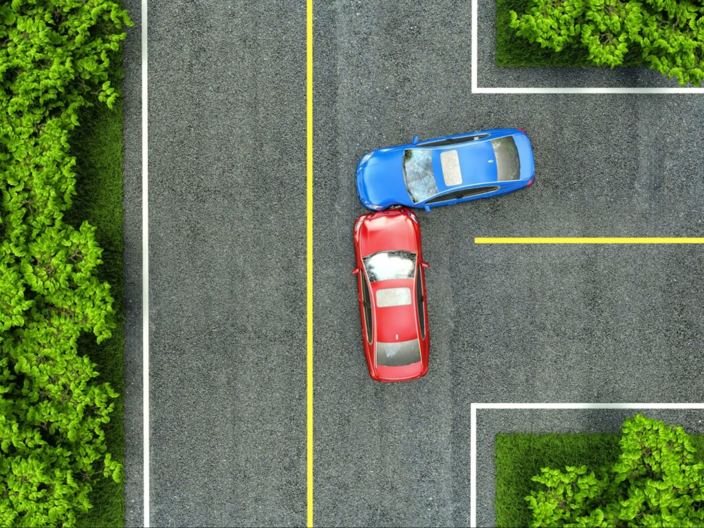 Aerial view of a side impact car accident at an intersection. After an accident, it is a good idea to contact an attorney to discuss your legal rights.
