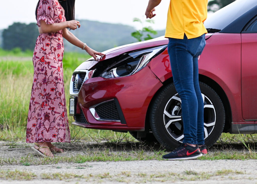 car accident insurance male female drivers after traffic accident people after car crash trying find friendly agreement