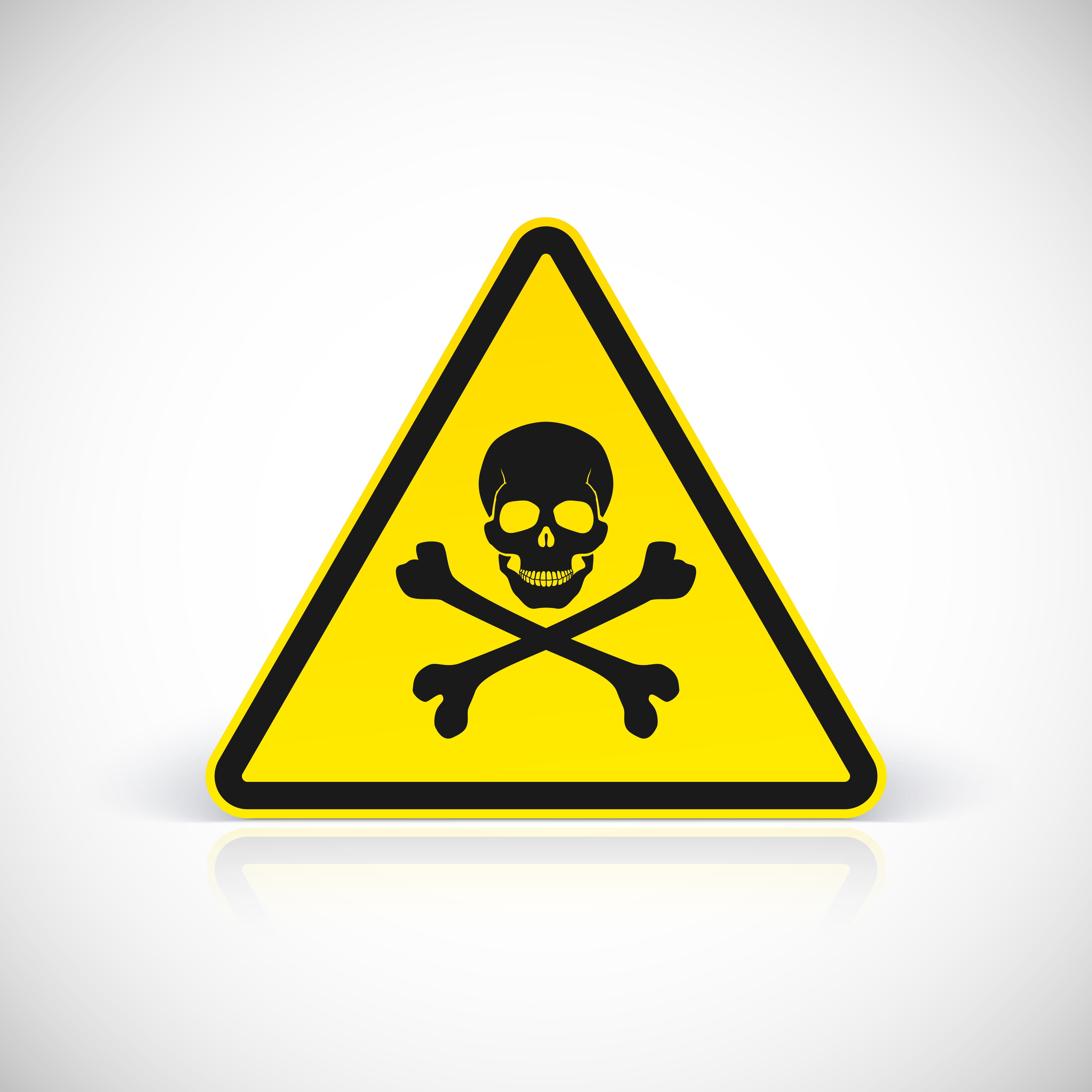 Triangular black and yellow poison warning sign with skull and crossbones.