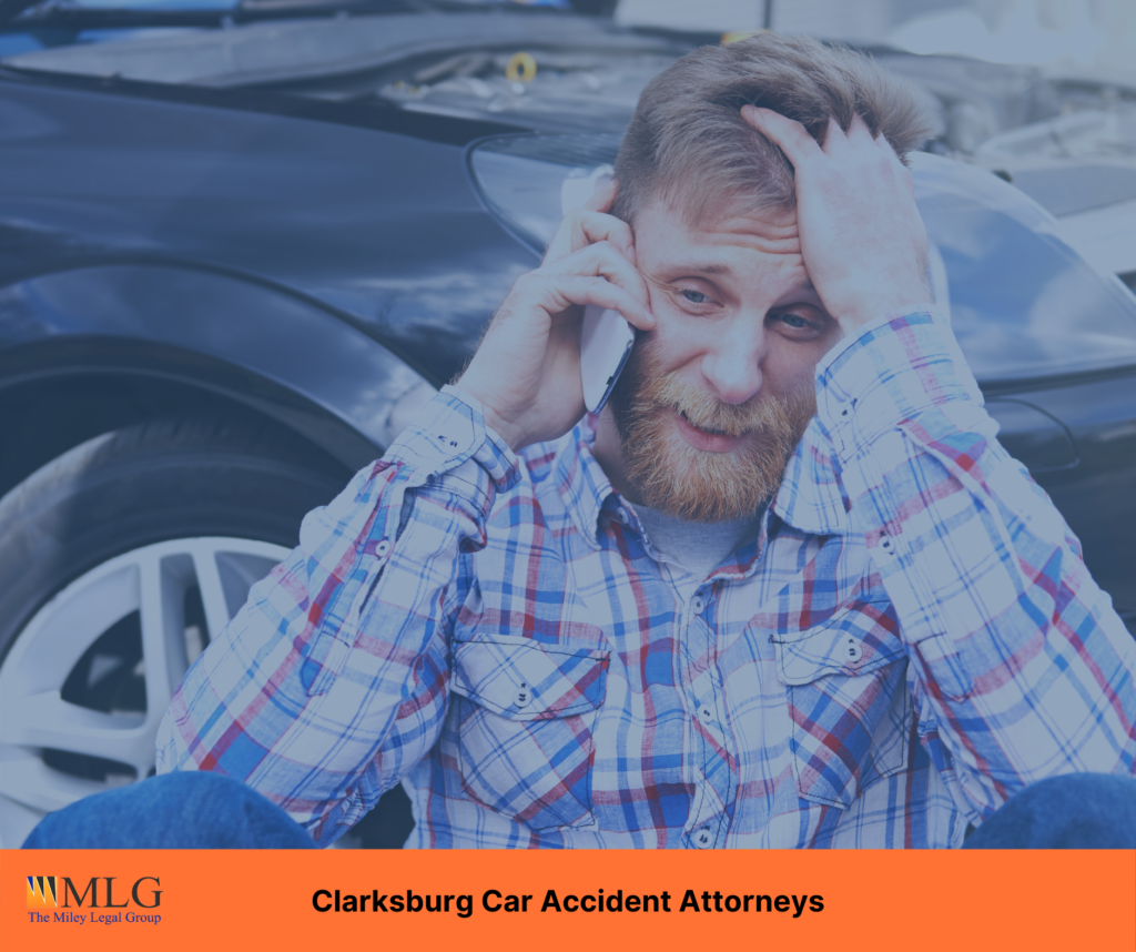 Man outside of his car calling a car accident attorney in Clarksburg, West Virginia after a car wreck