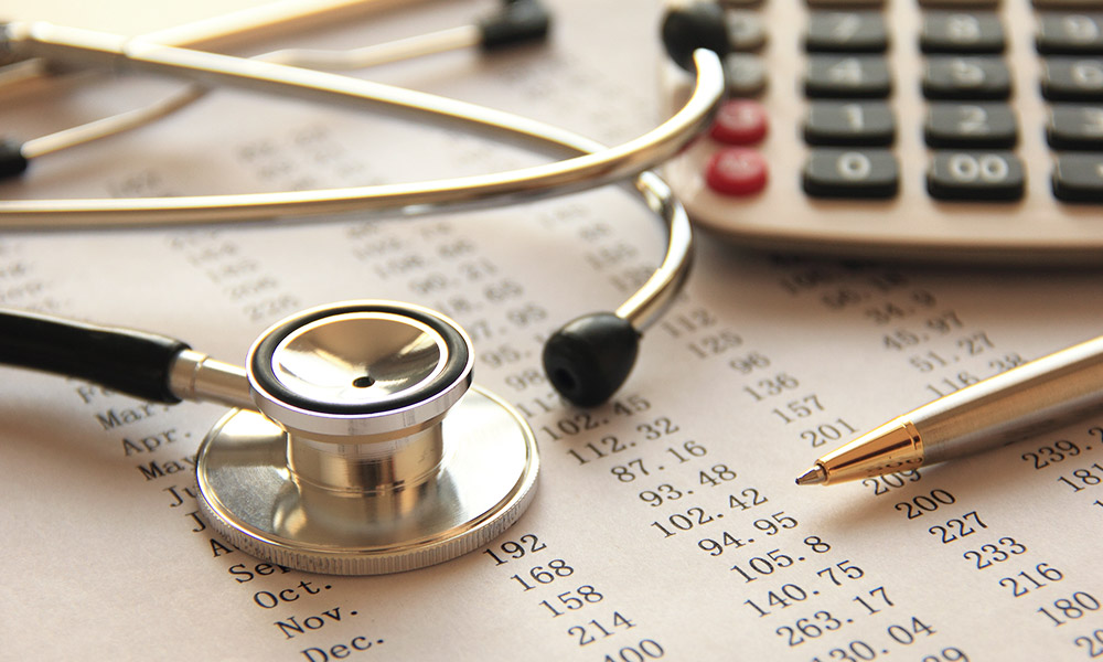 stethoscope and medical bills