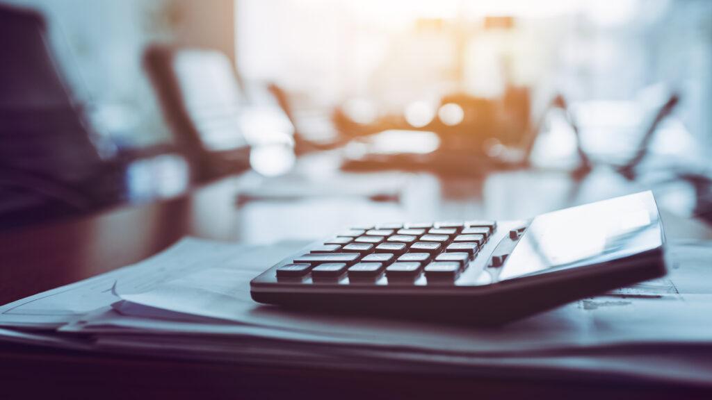 close up calculator business working desk dark background 1