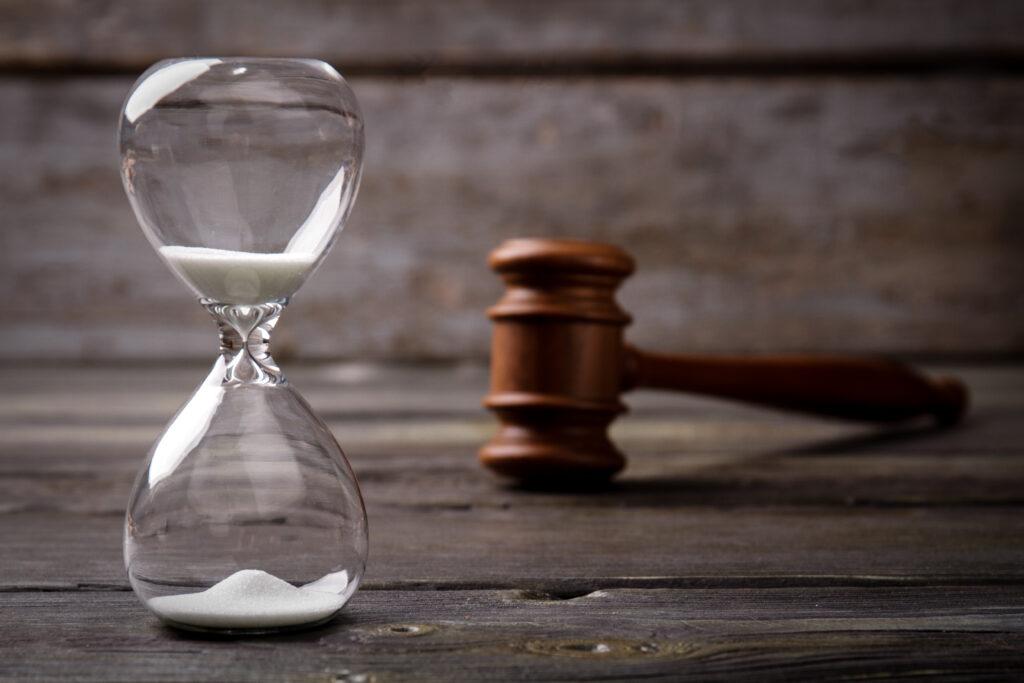 close up hourglass judge gavel 2