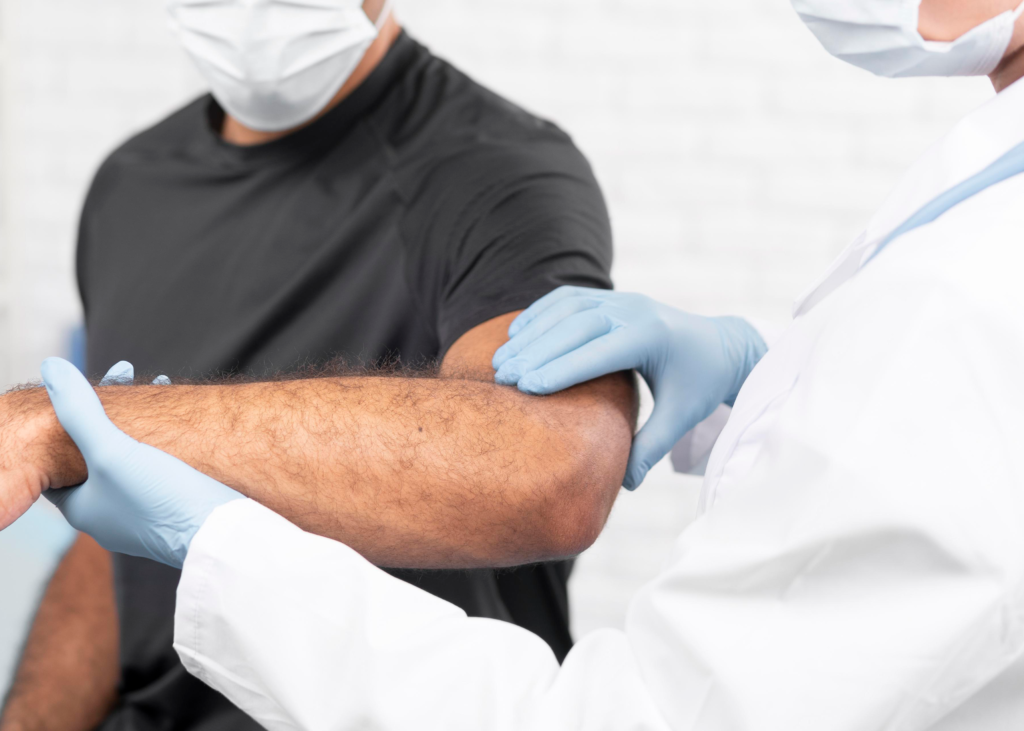 Female Dr. looking at patients elbow
