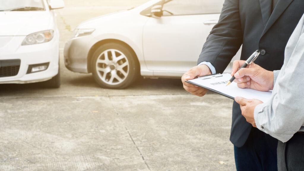 senior man insurance agent claim process after car crash